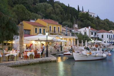 Typical Waterfront Taverna Illuminated at Dusk, Kioni, Ithaca (Ithaki) by Ruth Tomlinson