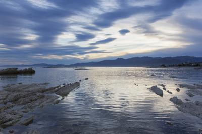 View across the tranquil waters of South Bay at dusk, Kaikoura, Canterbury, South Island, New Zeala