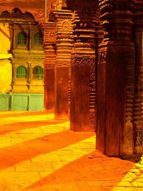 Carved Columns of the Jagannarayan Temple in Patan Illuminated at Night, Patan, Nepal by Ryan Fox