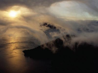 Clouds Sweeping Down into the Caldera at Sunrise, Crater Lake National Park, USA