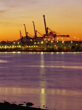 Cranes Unloading Cargo at Burrard Inlet at Dawn, Vancouver, Canada by Ryan Fox