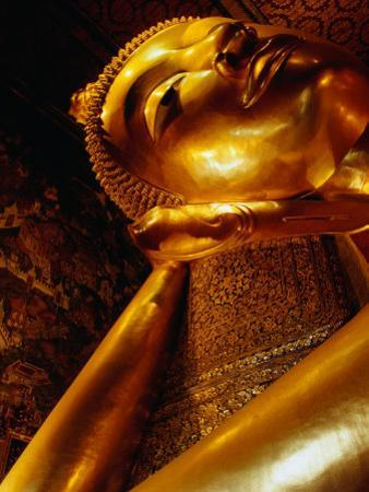Detail of Reclining Buddha's Head at Wat Pho, Bangkok, Thailand