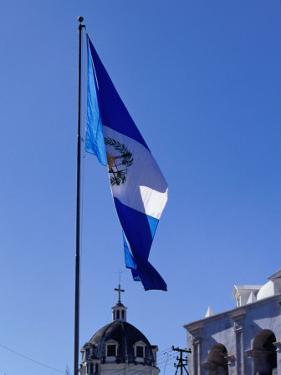 Guatemalan Flag Flying Over Municipalidad (Town Hall), Quetzaltenango, Guatemala by Ryan Fox