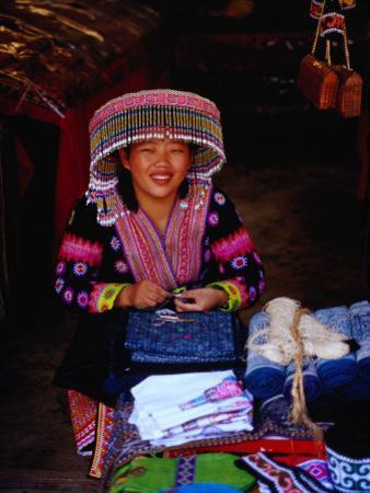 Hmong Village Woman Wearing a Tribal Hat at a Cloth Stall, Chiang Mai, Thailand