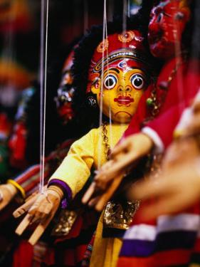 Marionettes of Hindu Deities Hanging Outside Shop, Kathmandu, Nepal by Ryan Fox