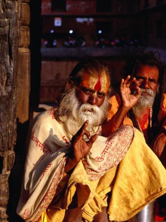 Portrait of Two Sadhus Making Hand Signals in Taumadhi Square, Bhaktapur, Nepal