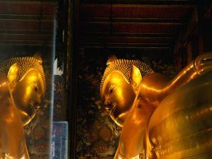 Reclining Buddha at Wat Pho, Bangkok, Thailand by Ryan Fox