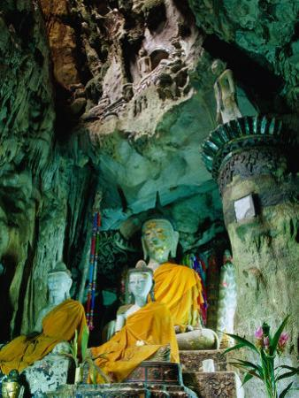 Seated Buddha Statues in Saffron Cloth Inside Cave, Chiang Dao, Thailand