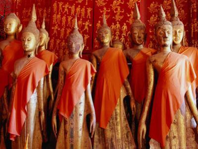 Statues Draped in Saffron in the Royal Funerary Carriage House at Wat Xieng Thong, Laos