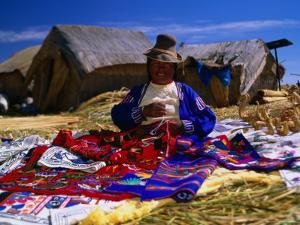 Traditionally Dressed Woman Knitting on Isla Flotantes by Ryan Fox