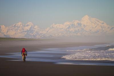 A Man Teasdale Fatbiking On A Remote Beach Near Yakutat, Alaska