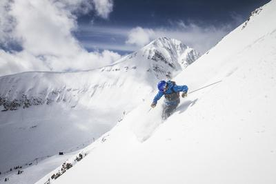 Male Skier Above The Pinnacles With Lone Peak In The Background Big Sky Resort, Montana