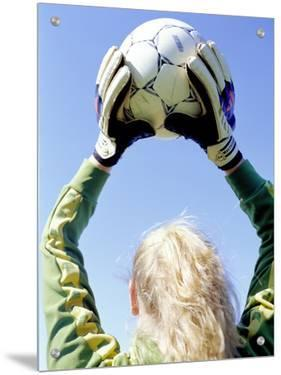 View from Behind of a Girl Holding a Soccer Ball by S.C.