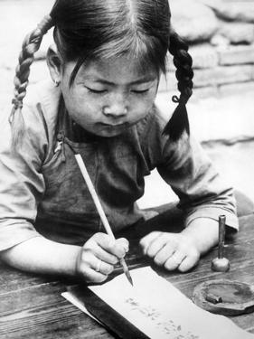 Chinese Girl Writing, 1940 by S?ddeutsche Zeitung Photo