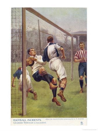 An Attacking Player Gives the Keeper a Firm Shoulder Barge Sending Him into His Own Net