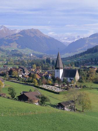 https://imgc.allpostersimages.com/img/posters/saanen-village-church-in-foreground-switzerland_u-L-P2KDFC0.jpg?artPerspective=n