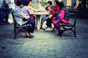 A Group of Asian Women Playing Cards in a Park in Chinatown, New by Sabine Jacobs