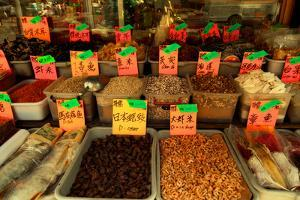 Dried Chinese Herbs, Mushrooms, and Spices in Front of a Grocery by Sabine Jacobs