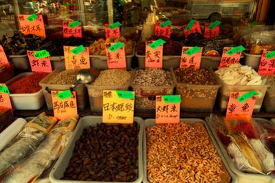 Dried Chinese Herbs, Mushrooms, and Spices in Front of a Grocery