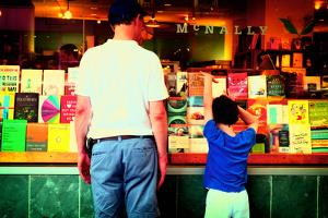 Father and Son Looking at Books Through a Shop Window, New York by Sabine Jacobs