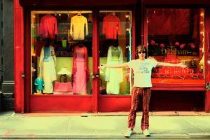 Man in Front of a Clothing Shop, New York City. by Sabine Jacobs