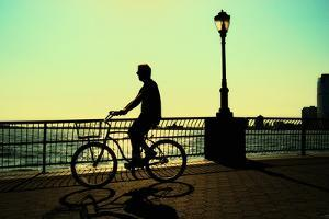 Man on a Bicycle, Battery Park, New York City by Sabine Jacobs