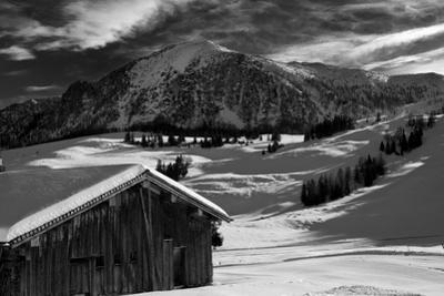 Monochrome Image of an Alpine Mountain Cabin in a Winter Landsca