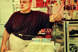 Street Vendor at a Market in Little Italy, New York City by Sabine Jacobs