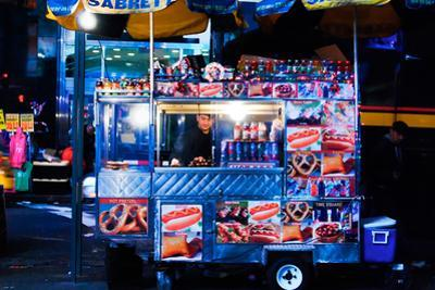 Street Vendor Selling Hot Dogs on Times Square at Night, Manhatt