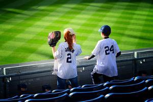 Two Young Baseball Fans Waiting for the Start of the Game, Yanke by Sabine Jacobs