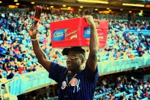 Vendor Selling Cold Beverages at a Baseball Game in Yankee Stadi by Sabine Jacobs