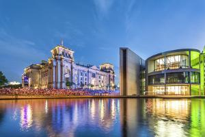 Illuminated Reichstag and Paul Lobe Haus, River Spree, Berlin, Germany by Sabine Lubenow