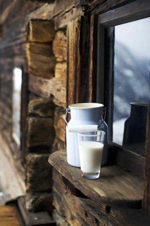 Milk Can and Glass of Milk on Window Sill of Alpine Chalet by Sabine Mader