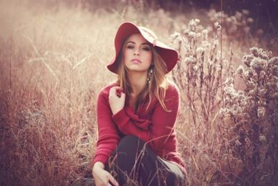 Young Woman Outdoors Wearing a Red Hat