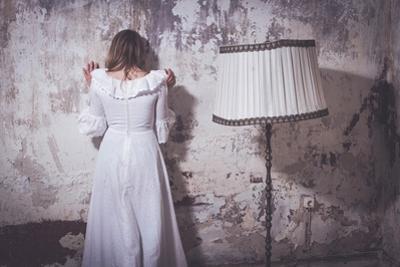 Young Woman Wearing White Dress