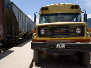 Bus Truck Waiting at Train Station by Sabrina Dalbesio