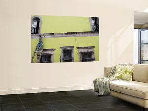 Painter Restoring Building by Sabrina Dalbesio