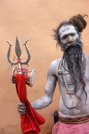 https://imgc.allpostersimages.com/img/posters/sadhu-with-shiva-trident-attending-haridwar-kumbh-mela-haridwar-uttarakhand-india_u-L-Q1GYI880.jpg?artPerspective=n