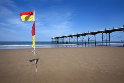 https://imgc.allpostersimages.com/img/posters/safe-bathing-flag-on-the-beach-at-saltburn-by-the-sea_u-L-PNFYV10.jpg?artPerspective=n