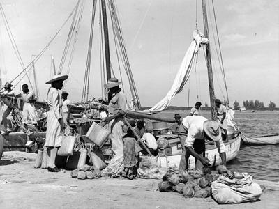 https://imgc.allpostersimages.com/img/posters/sailboats-docked-at-eleuthera-bahamas-c-1955_u-L-PPQY120.jpg?p=0