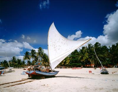 Sailing boat Jangada at Combuco Beach near Fortaleza, Ceara, Brazil