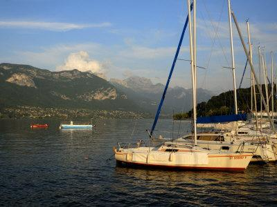 https://imgc.allpostersimages.com/img/posters/sailing-boats-in-evening-light-moored-on-lake-annecy-rhone-alpes-france-europe_u-L-P7XHHO0.jpg?p=0