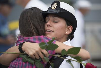 Sailor Hugs Her Daughter after Returning from Deployment