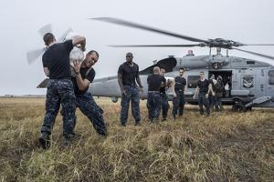 Sailors Load Relief Supplies onto an Mh-60R Sea Hawk Helicopter
