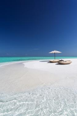 Two lounge chairs with sun umbrella on a tropical beach, The Maldives, Indian Ocean, Asia by Sakis Papadopoulos