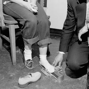 Salesmen Helps Woman with Safety Work Shoes, Ca. 1943