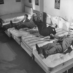 Salesmen Showing How Not to Test a Bed