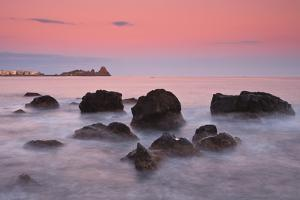 Italy, Sicilia, Sicily, Last Light at Dusk, in the Background the Cyclopes Stacks of Acitrezza by Salvo Orlando