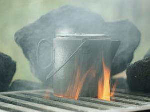 Coffee Pot Steaming over a Campfire by Sam Abell