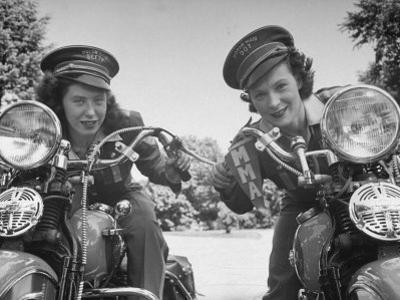 Woman and Her Daughter Sharing Interest in Motorcycle Racing by Sam Shere